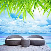 Wicker Sofa Beds on Sea Background