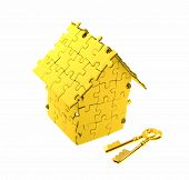 key with House built out of puzzle pieces
