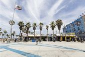 LOS ANGELES, CALIFORNIA - JUNE 20, 2014:  Shops and palm trees along the funky Windward Plaza at Ven