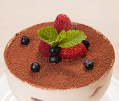 Tiramisu cake in glass with small fruits