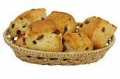English scones in wicker basket isolated on white