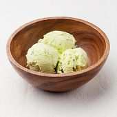 Pistachio Ice Cream In Wooden Bowl
