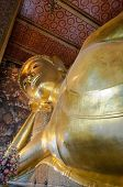 Face Of Reclining Buddha Gold Statue In Wat Pho Buddhist Temple, Bangkok, Thailand