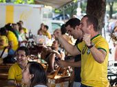 Cheerful Brazil Fans Celebrating Victory at World Cup Football Match at a Bar