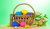 Basket with eggs, sweet jewelry and alstroemeria