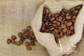 Coffee beans in jute bag with copy space