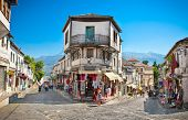 GJIROKASTER, ALBANIA - JUNE 07, 2014: Unidentified locals in a street scene at the center of histori