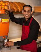 Cheerful Chef Making Fresh Orange Juice
