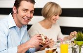 Couple Enjoying Delicious Breakfast