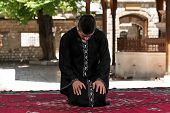 Humble Muslim In Dishdasha Prayer