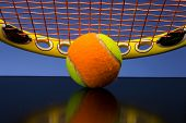 Tennis ball for children with tennis racket and green grip