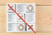 foto of tic-tac-toe  - Game of Tic Tac Toe on wooden background - JPG