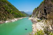 stock photo of raft  - Rafting boat in  river Gang near Rishikesh - JPG