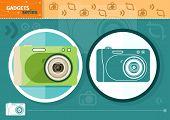Digital camera in frame on green background