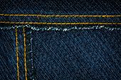stock photo of denim jeans  - Worn dark blue denim jeans texture with stitch - JPG