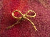 Twine bow centered on Irish wool.