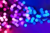 stock photo of ombre  - Pink purple and blue defocus lights abstract background - JPG
