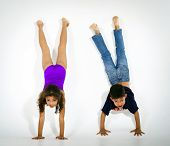 Young Active Afro-american Children Doing Gymnastics