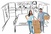 Attractive young couple with moving boxes against kitchen sketch