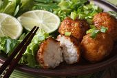 Fish Balls With Lime And Salad On A Plate Macro. Horizontal