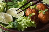 Fish Balls With Lime And Salad And Chopsticks Macro. Horizontal