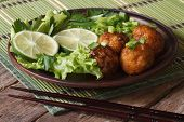 Fish Balls In Curry Sauce With Lime And Fresh Herbs Horizontal