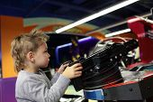 Kid Playing A First Person Shooter