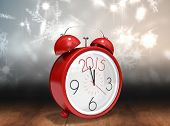 stock photo of shimmer  - 2015 in red alarm clock against shimmering light design over boards - JPG