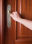 Hand Gripping The Handle Of A Door
