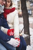 Guy and girl in winterwear holding Bengal light