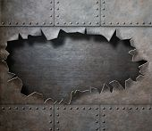 damaged metal armor with torn hole steam punk background