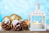 Christmas lantern with decorations and snow