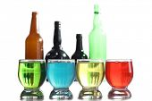 Color cocktails in glass beakers on white background