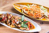 stock photo of clam  - thai style Fried Baby Clam and vegetable on wooden table - JPG