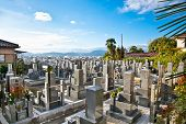 KYOTO, JAPAN - OCT 23, 2014: Buddhist cemetery on Oct 23, 2014 in Kyoto, Japan. The Japanese bury their dead by Buddhist traditions.