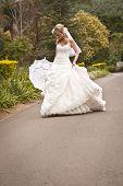 Young beautiful blonde bride enjoying a walk outdoors