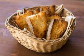 stock photo of nic  - slices of toasted bread and served in a basket - JPG