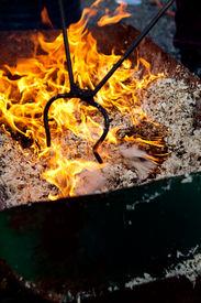 pic of raku  - A raku burning pit filled with wood chips - JPG