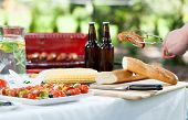 pic of grilled sausage  - Horizontal view of grill in the garden - JPG