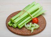 foto of celery  - Fresh Green Celery sticks on the wood background - JPG