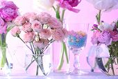 pic of vase flowers  - Beautiful spring flowers in glass vases on light pink background - JPG