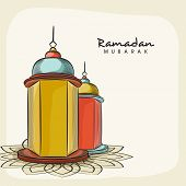 stock photo of ramadan mubarak  - Illuminated arabic lanterns on floral decorated beige background for Islamic holy month of prayers - JPG