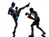 stock photo of kickboxing  - one woman boxer boxing one man  kickboxing in silhouette isolated on white background - JPG