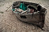 picture of shingles  - An old boat on a shingle beach - JPG