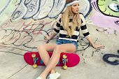 foto of swag  - Beautiful and sexy street girl with her skateboard - JPG