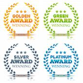 stock photo of award-winning  - Illustration of a set of elegant awards winning laurel wreath and crowns in golden green leaves silver and platinum diamond on white background - JPG
