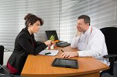 stock photo of rep  - a Pharmaceutical Sales Representative at hospital with a doctor - JPG