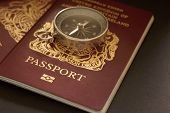 image of citizenship  - British passports and compass a travel or vacation concept - JPG