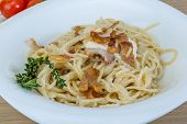 foto of carbonara  - Pasta carbonara with sauce and bacon served thyme - JPG