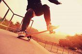 stock photo of skate board  - skateboarder riding on skateboard at skate park - JPG